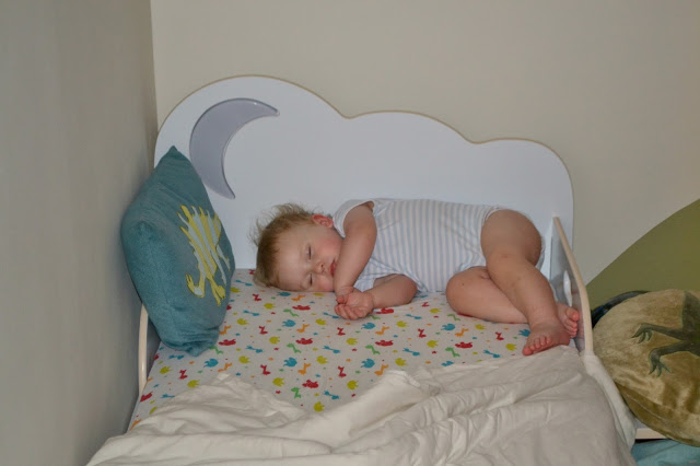 HelloHome StarBright toddler bed and a child sleeping sideways