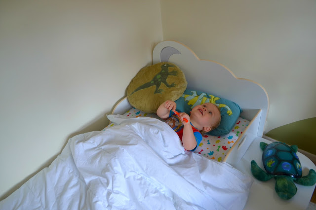 child watching the light in HelloHome StarBright toddler bed
