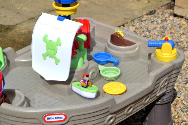 Little Tikes Anchors Away Pirate Ship set up outdoors