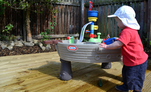 child playing with Little Tikes Anchors Away Pirate Ship