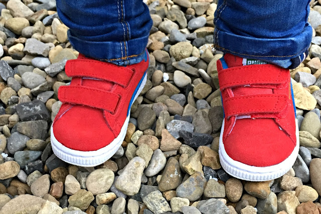 Get the Label red Puma kids trainers being worn by a child