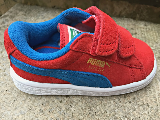Get the Label red Puma kids trainers side view